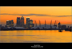 Sunset River (Aubrey Stoll) Tags: uk windows sunset england london thames river lights europe britain tripod o2 eu millennium dome d200 polarizer canarywharf spikes barges capitalcity 70300mmlens
