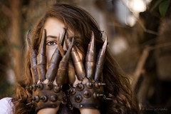 peek a boo -- i see you... (helen sotiriadis) Tags: china portrait brown green halloween canon death scary dof bokeh antique depthoffield gloves claw warrior manicure nix scissorhands canonef50mmf14usm canoneos40d