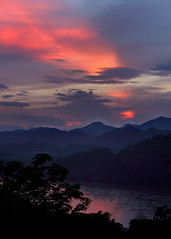 Sunset Over the Mekong (Rob Kroenert) Tags: sunset clouds river that landscape asia southeast laos mekong luangprabang luang prabang thatchomsi chomsi