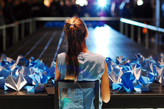 .. (Js) Tags: blue toronto art girl night paper table lights focus dof bokeh 85mm hues folding nuitblanche 2010 vexations 85mmf18d brokefieldplace