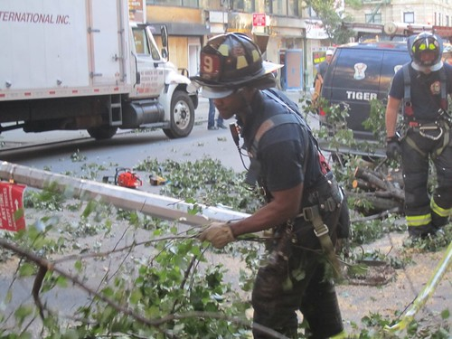 Firefighters clear away debris
