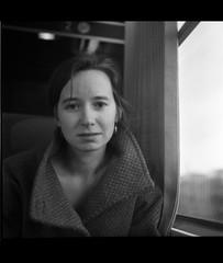 Portrait AH. (glucozze) Tags: portrait bw blur 6x6 girl train mood grain smudge nb flou