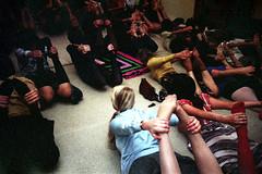 61-012 (nick dewolf photo archive) Tags: people woman color film boston yoga 35mm pose 1974 women massachusetts nick shiatsu mass 1970s position leotard underexposed 61 dewolf unitard yogaclass dhanurasana yogagroup nickdewolf photographbynickdewolf bowpose reel61