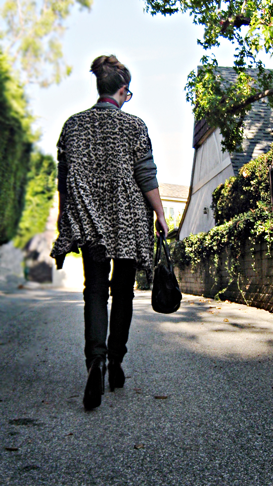 leopard dress as a jacket over jeans and a sweater