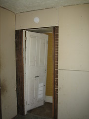 Basement door, between south and center wing