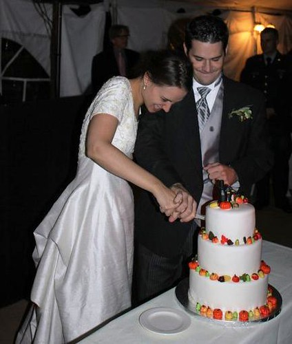alyssa and carl cutting cake 2010