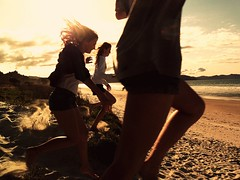 (kneeecoal) Tags: girls sunset sea sun beach clouds running run rush