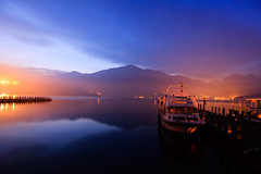 Autumn Dawn in Sun Moon Lake (samyaoo) Tags: lake mountains reflection clouds sunrise pier boat taiwan  wharf     sunmoonlake nantou