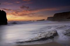 Panther3 (fwukai (in time-lapse mode)) Tags: california santa sunset seascape beach rock wall canon landscape rebel sand long exposure hole wave filter cruz davenport panther xsi gnd singhray scphoto