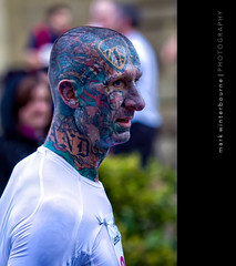 Character.... (Mark Winterbourne | markwinterbourne.com) Tags: people white black colour abbey tattoo race neck fun photography photo body head united leeds bald running run full dash spectators jogging runner journalism westyorkshire skinhead 2010 yeadon colout lufc disabledphotographer bradfordleeds markwinterbourne