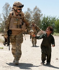 A Royal Military Police Sergeant with an Afghan Child During a Routine Patrol (Defence Images) Tags: uk boy afghanistan soldier army child military afghan british op operation campaign defense defence afganistan personnel herrick helmand partnering identifiable afghannationalarmy gcompany 1stbattalionthemercianregiment fobkharnikar
