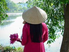 Asian woman in traditional dress with flowers (phuong.sg@gmail.com) Tags: aodai asia asian beautiful beauty blue bouquet bud bunch culture cute desert dress female flower girl holding indochina lotus material model naive obesum orchid outdoor people pink pool portrait purity purple rose silk smile smiling tradition traditional vietnam vietnamese violet water wearing wet woman women