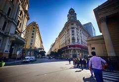 Downtown Buenos Aires, Argentina (` Toshio ') Tags: toshio buenosaires argentina city southamerica people downtown plazademayo street cars crosswalk fujixe2 xe2 ministeriodemodernizacióndelanación