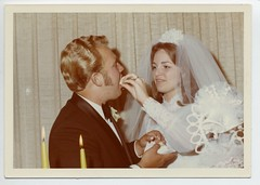 The feeding of the cake (Awkward Boy Hero) Tags: oregon portland groom bride candles northwest lace weddingcake beaverton tuxedo oldphotos vintagephotos foundphotos antiquephotos somanyuniquetreasures exceptmaybenotoregon awkwardboyhero