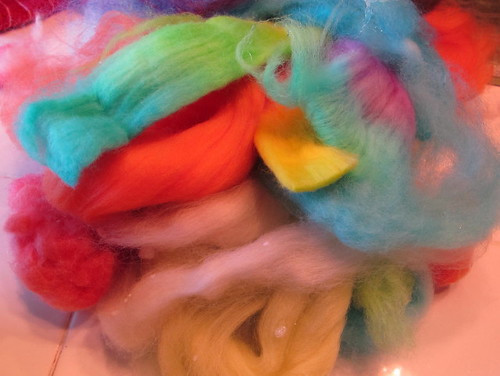 Pile of new colorful wool roving....