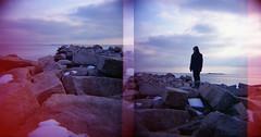 standing alone (snacky.) Tags: winter snow film beach water toy lomo rocks lightleak plastic diana konica expired 220