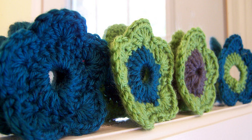 4 Crocheted Flowers on Mirror Frame