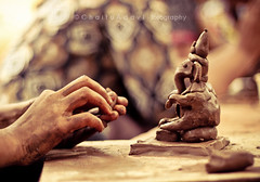 Ganesh under-construction  [E X P L O R E ] and FRONT PAGE ( C H A I T U) Tags: 50mm ganesha construction hands hand bokeh under made ganesh friendly eco making preparation chaitu