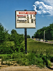 Remember when gas was this cheap? Yeah....neither do I! (Nicholas Ortloff Photography (Is Back)) Tags: cloud abandoned gas gasstation oil gasoline cheap mn northfield cheapgas photoshopcs4 topazadjust
