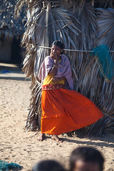 Timide (hubertguyon) Tags: orange woman india girl vent village dress wind robe femme shy orissa inde timide chandrabhaga earthasia
