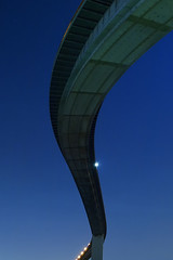 snake in the sky (k n u l p) Tags: city bridge blue light sky ikea japan architecture night shaped snake surreal s olympus clear  osaka e3 zd 1454mm namihaya   100