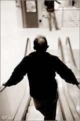 ESCALATOR (Tyrone Fleming) Tags: shopping escalator leeds nikonf6 fujineopan100 leedscitycentre planarlens gwtphotography carlzeissplanar1450mmzf2lens zf250mm14lens
