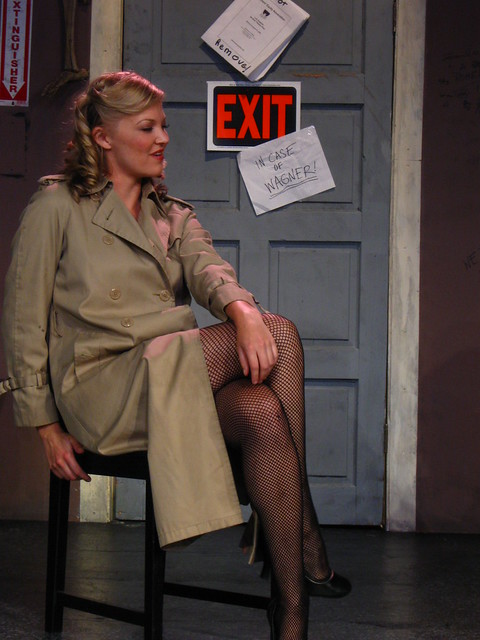 Miss Astor (Erin Holt) seduces him into taking a case he knows is probably a setup.