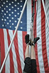 SOOC. (hyekab25) Tags: blue red usa white black feet boston metal america stars us scary bars escape pants legs upsidedown boots stripes flag massachusetts fear americanflag rope negative american hanging streetperformer trick hang quincymarket escapeartist blackboots hangingbyhisfeet hangingupsidedown