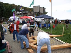 The Mother Earth News Fair - Raising 4 (Riverbend Timber Framing) Tags: homes house canada news green beautiful architecture farmhouse america design us cabin exterior unitedstates earth timber cottage mother fair frame northamerica framing custom hybrid luxury sustainable sustainability riverbend cabins raising timberframe timberframing timberframehomedesign customhomedesign timberframeplans timberframeexterior