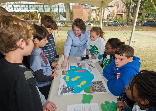 Deputy Secretary Kathleen Merrigan and fifth grade student from Hearst Elementary School in Washington, DC,  discuss the effect of algae on water. The experiment was part of the 4-H National Youth Science Day, National Science Experiment, 4-H2O, Tuesday, October 6, 2010. Students learned about the importance of water quality and its impact on the environment with experiments to discover how to reduce their carbon footprint. USDA Photo 10di1518-14 by Bob Nichols.