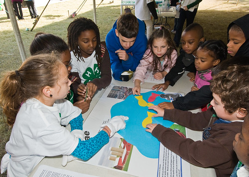 Carolina Bayon (left) a fifth grade student at Hearst Elementary School in Washington, DC,  explains the effect of algae on water quality to second grade students. The experiment was part of the 4-H National Youth Science Day, National Science Experiment, 4-H2O, Tuesday, October 6, 2010. Students learned about the importance of water quality and its impact on the environment with experiments to discover how to reduce their carbon footprint