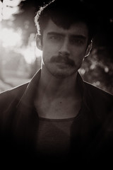 (mis.flores) Tags: portrait blackandwhite bw dylan male fall 50mm depthoffield lensflare mustache 18 shortdof canon7d