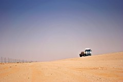 lonely desert trucker (zbigphotography (1M+ views)) Tags: truck fence sand loneliness desert middleeast heat arabia saud