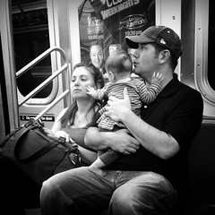 Reaching Out... (antonkawasaki) Tags: newyorkcity blackandwhite bw portraits candid streetphotography squareformat everybodylovesraymond fatherholdingbaby 500x500 thekingofqueens iphone4 subwaylife iphoneography antonkawasaki babyreachingoutandplacinghandonwomansface elinenyc womaninanotherworld