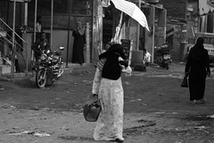(jonmartin ()) Tags: africa street people blackandwhite bw woman fashion female america person blackwhite clothing women veil memphis feminine egypt hijab streetphotography clothes cairo human arab activity niqab humanbeing humans apparel activities humanbeings womensclothing attire womanly womensapparel cvkc