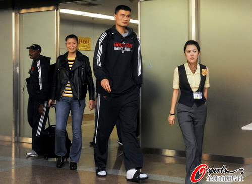 October 12th, 2010 - Yao Ming arrives at Beijing with wife Ye Li for the 2010 NBA China Games