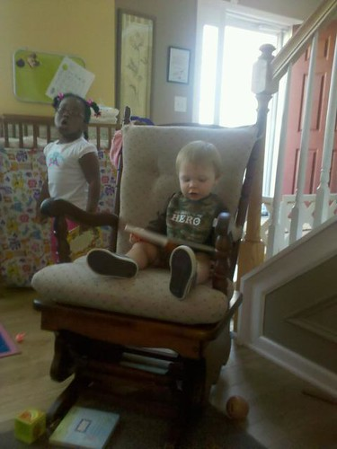 101001 Coleman reading to kids at daycare