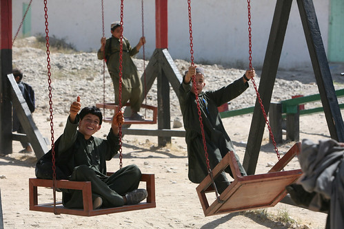 Afghan children play on refurbished playground
