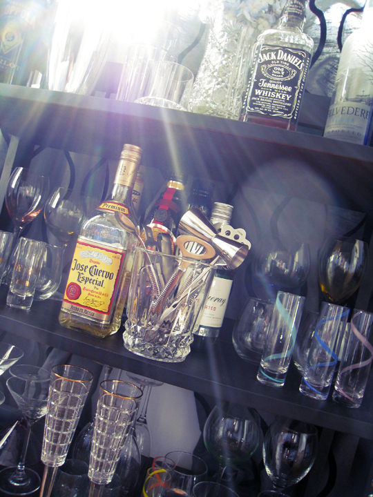 booze display+home bar+mini bar+wine glasses+jose cuervo+ralph lauren champagne glasses+shelves into a home bar DIY