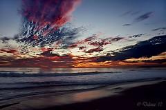 Fire! (Didenze) Tags: seascape reflection texture twilight sand glow surfer dramatic orangecounty sanclemente skyonfire stormyclouds canonrebelxsi didenze
