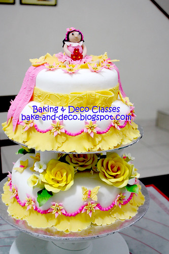 Three tier & stack fondant cake with figurines