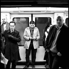 Hard metro guys (anders.rorgren) Tags: street bw copenhagen square ipod metro candid