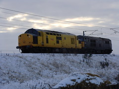 97301 & 31459 'Cerberus' pass Hensall in the snow on 8X03. (30.11.10) (Michael 43123) Tags: uk snow heritage yellow movement rail move class network 37 31 plough 97 departmental livery cerberus duties diesels 31459 fragonset 37100 hensall 97301 8x03