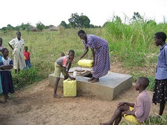 Hauling Water (dreamofachild) Tags: poverty water children village african poor orphan orphanage uganda humanitarian villagers eastafrica pader ugandan northernuganda kitgum humanitarianaid aidsorphans waraffected childcharity lminews