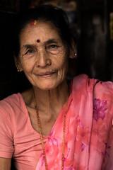 Faces of Nepal Series: Pretty In Pink. (Jessica Amity) Tags: kathmandu nepal nepal2017 patandurbarsquare historicalcity worldheritagesite woman nepalesewoman localwomen travel travelphotography travelportrait portraitworld peoplebeingpeople people peopleoftheworld peopleofnepal justpeople portrait portraitphotography portraitproject portraits portraitsofnepal portraiture streetportrait streetportraitphotography facesofnepal facesofnepalseries nikond5300 nikon nikoncamera nikonprofessional nikkor nikon50mm nikonlens nifty50 50mm 50mmlens 50mm18 sari pink pinksari culture