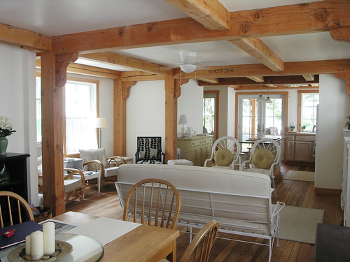 lakeside green cottage timber frame home living room