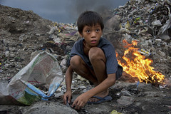 Smoky Mountain, Tondo - Child Scavenger of Smoky Mountain (Mio Cade) Tags: boy mountain hot home boys girl rain kids work children toy site kid dangerous garbage shine child little reptile snake labor philippines dump dirty scorpion help rubbish manila bite smoky dig scavenger peso tondo