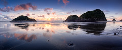 Sugarloaf Reflections (Mark Solly (F-StopNinja)) Tags: sunset sky panorama reflection beach wet islands sand waves stones pano shoreline panoramic shore sugarloaf taranaki newplymouth cloude sigma1020mm backbeach nikond90