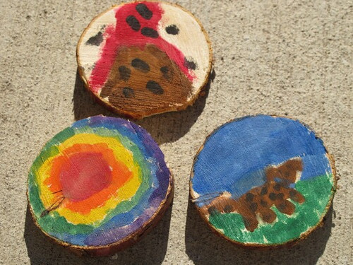 All three of his painted wood coins