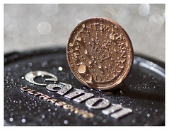 Half penny Canon, explored! (Ianmoran1970) Tags: wet water canon bokeh drop penny half expensive lenscap cheap halfpenny ultrasonic explored hbw ianmoran macromonday macormondays ianmoran1970
